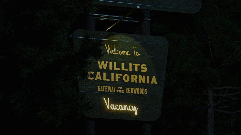 motel signage at night
